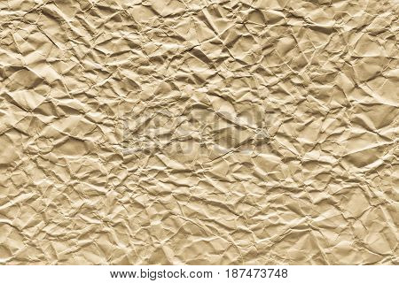 old crumpled sheet paper of cream color for the abstract textured background and for wallpaper