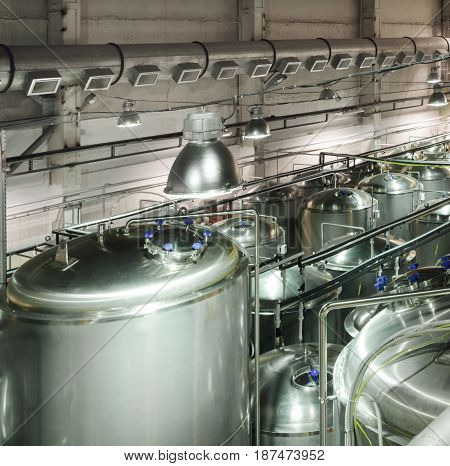 Metal tanks for storage and processing of food liquids. Modern food production.