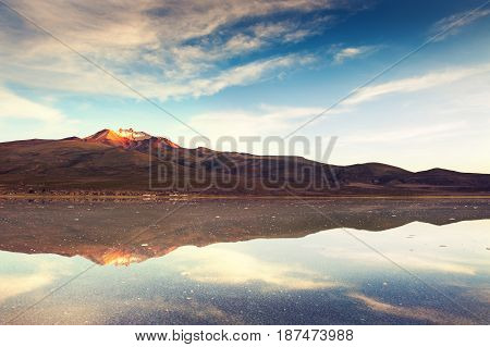 Salt Flat Salar De Uyuni And Volcano Tunupa At Sunrise, Bolivia