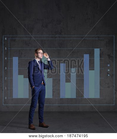 Businessman standing on a column diagram background. Business, office, career, job concept.