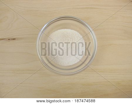 Prebiotic ingredient inulin powder in glass bowl