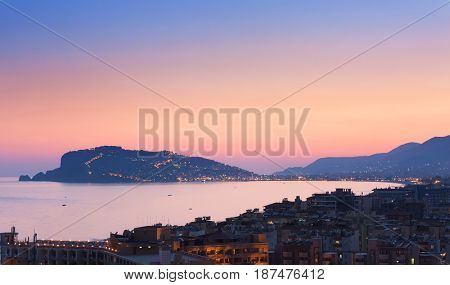 Cityscape of Alanya  at  the sunset, Turkey. At the background  Alanya Peninsula