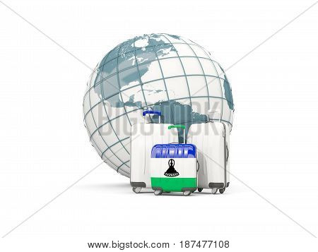 Luggage With Flag Of Lesotho. Three Bags In Front Of Globe