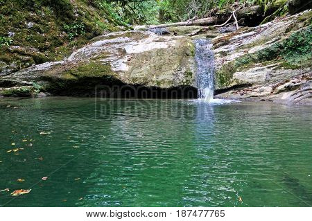 Small hadzhipse scenic river waterfall in the North Caucasus mountains.