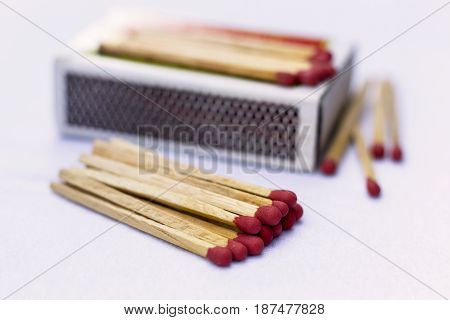 Box of matches on a wooden table shot at close-up