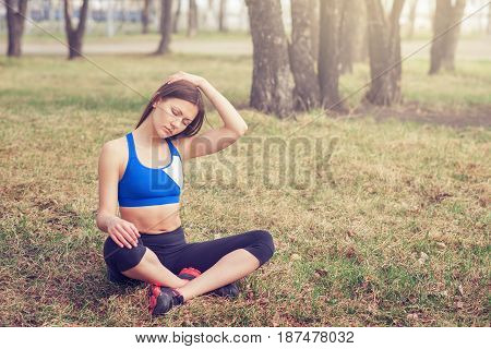 young woman warming up before a run.a healthy way of life. sports fitness yoga meditation.