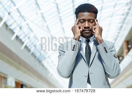 Pensive and tense businessman concentrating on making decision