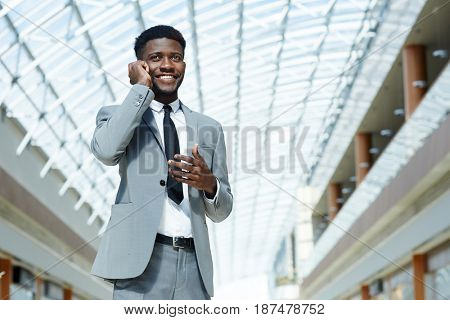 Confident business leader calling by cellphone