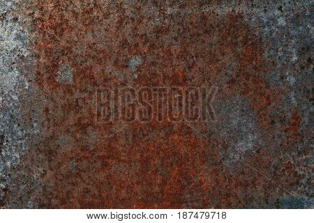 Grungy and rusty iron metal wall with heavy corrosion background texture