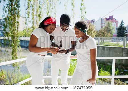 Three Stylish And Trendy African American Friends, Wear On White Clothes. Street Fashion Of Young Bl