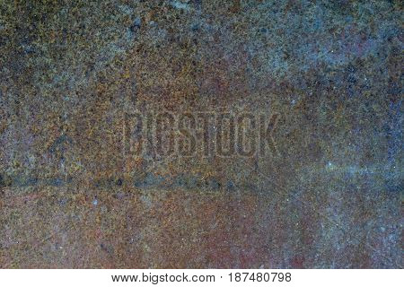Ferruginous iron metal wall with heavy corrosion background texture