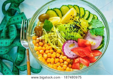 Buddha bowl - zucchini pasta tape measure centimeter. Weight loss on a vegan diet concept.