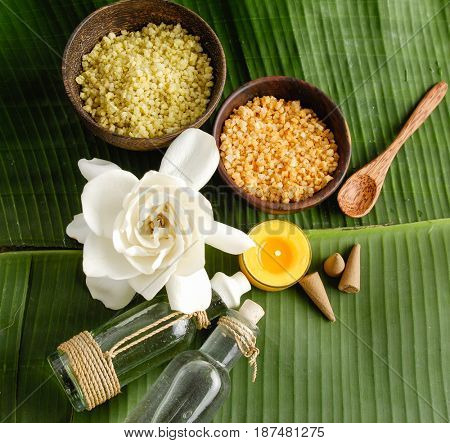 Tropical spa sitting and banana leaf with white flower