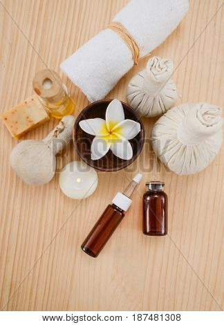 Spa treatment with salt in spoon ,ball on wooden board background
