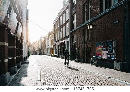 Utrecht Netherlands - August 4 2016: People and bicycles in street in historic centre of Utrecht. Ancient city centre features many buildings and structures several dating as far back as the High Middle Ages.