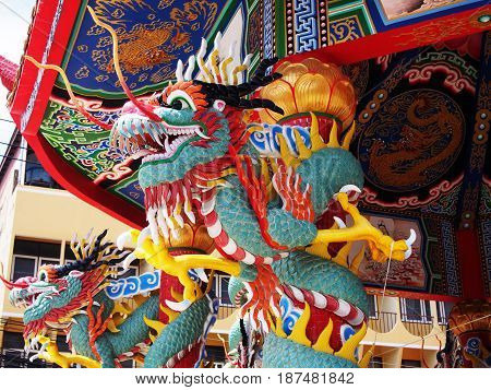 Photo of Chinese dragon wrapped around red pole