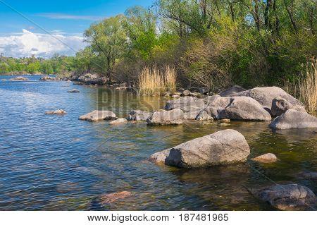 Landscape with rocky Dnipro riverside on a Khortytsia island in Zaporizhia city Ukraine.