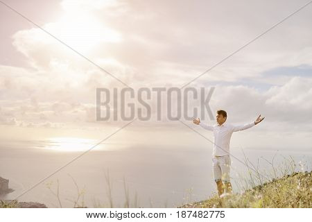 Young caucasian man with arms wide open - relax freedom success concept