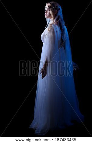 Young elven girl isolated on black