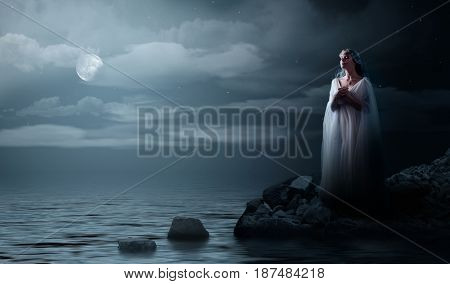 Elven girl on night sea coast