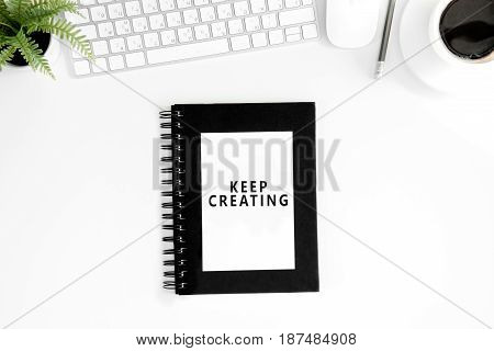 Flat Lay With Keep Crearing Motivational Quote On Diary, Computer Mouse And Keyboard Isolated On Whi