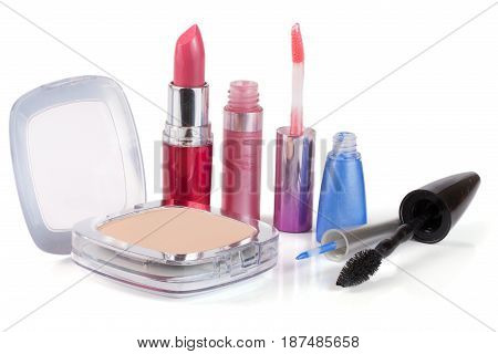 Make-up powder, lipstick, lip gloss eyeliner and mascara isolated on white background.