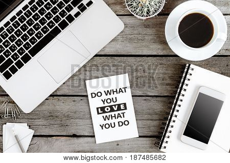 Top View Of Do What You Love And Love What You Do Motivational Quote On Modern Workplace With Wirele