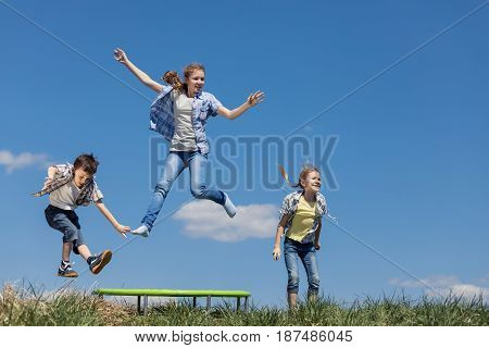 Brother And Sisters Playing On The Field At The Day Time.