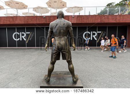 FUNCHAL PORTUGAL - SEPTEMBER 3 2016: The staue Christiano Ronaldo before the entry to the Museum CR 7 in Funchal on Madeira. Portugal