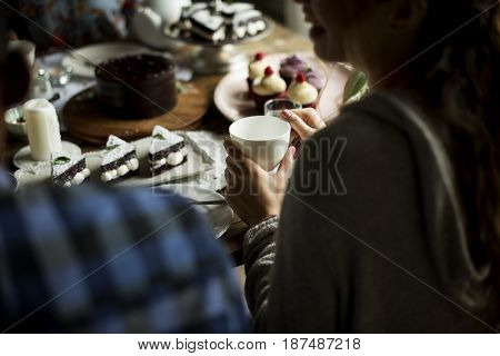 People celebrate birthday party with cake
