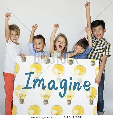 Young children holding banner graphic imagine