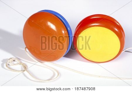 Two brightly coloured jojos isolated on a white background.