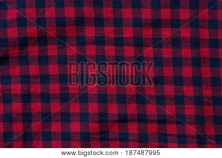 Cloth checkered texture with blue and red stripes, close-up