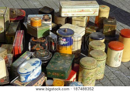 A wide collection of tin cans in various shapes and sizes standing out on the street.