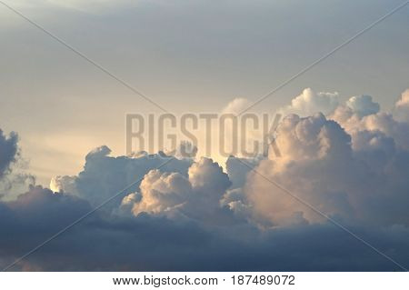 A romantic top view of white clouds made marvelous by the play of light.