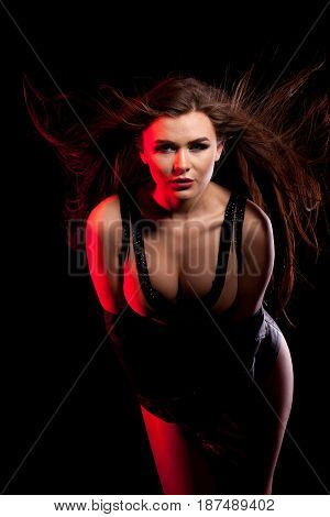 Passionate woman with big breast on black background in studio photo. Sexy and beauty. Fashion and seductive