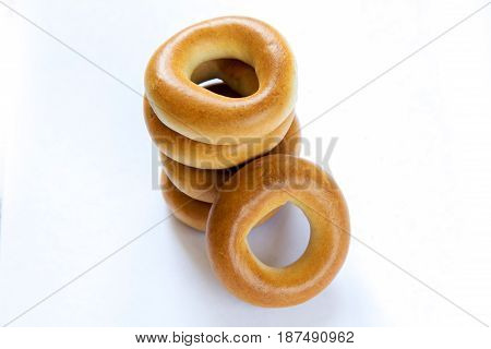 Pile of dry bagels isloated on white background