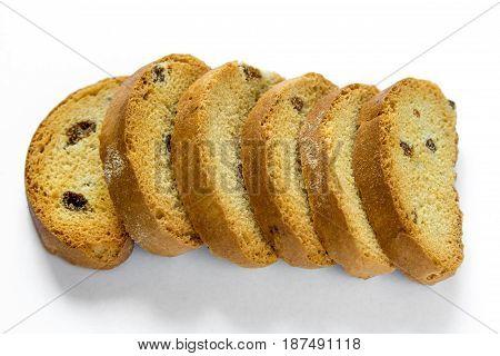Raw of slised crunchy toasted bread with raisins isolated on white background