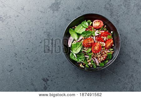 Buckwheat salad with cherry tomatoes and baby spinach