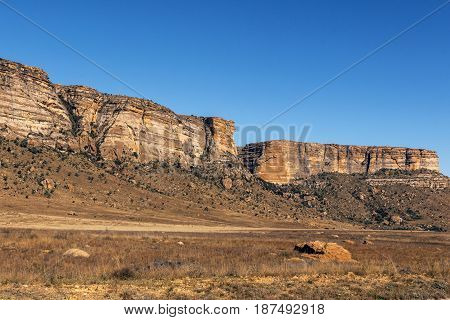 Golden Cold Dry Winter Landscape And Rocky Mountain
