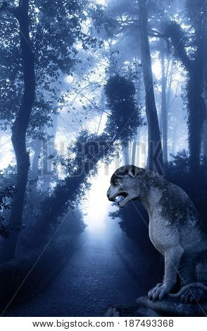 Mysterious landscape with ancient lion statue, road and trees in foggy forest