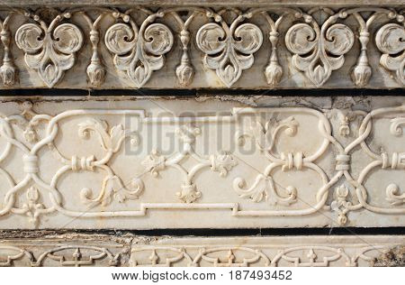 Ancient carved flower on marble in Taj Mahal mausoleum, Agra, India