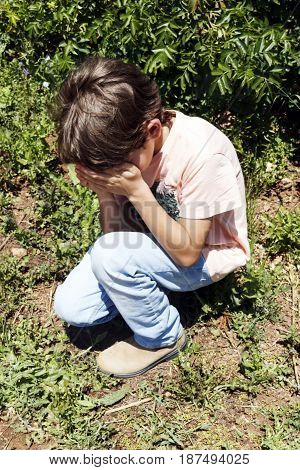 Boy Crying In The Park
