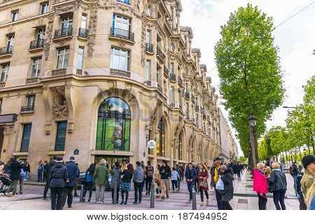 Paris France - May 1 2017: Beautiful architecture on Champs-Élysées Avenue with a crowd on May 1 2017 at Paris France.