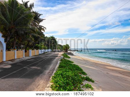 Empty  road along the ocean's beach, Mahe, Seychelles.