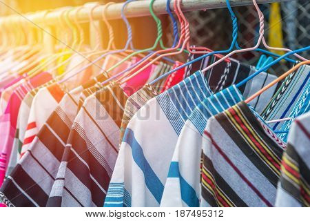 Colorful Clothes Fashion Hang On A Shelf At Flea Market Shopping In Town