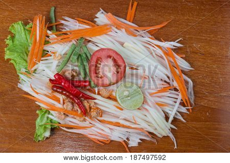 delicious papaya salad is thai food on wooden table