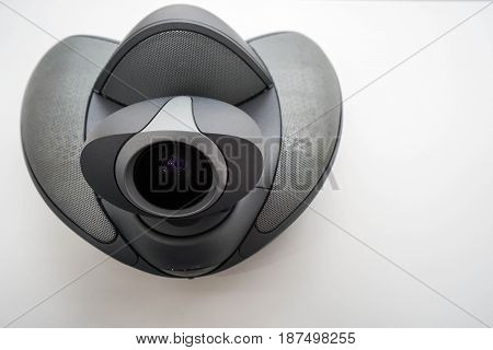 top view of conference phone with camera on table in office boardroom