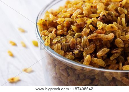 Raisins in bowl over wooden background. raisins in a glass bowl. Fresh organic raisins