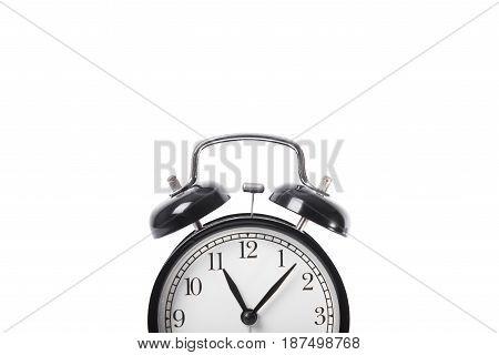 black alarm clock isolated on white table background.